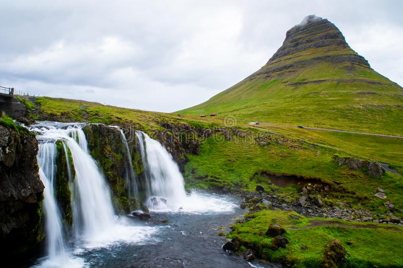 Kirkjufell volcano mountain, long exposure waterfall,  Iceland. Scenic panorama view of long exposure falling water in front of Kirkjufell volcano mountain, the royalty free stock images