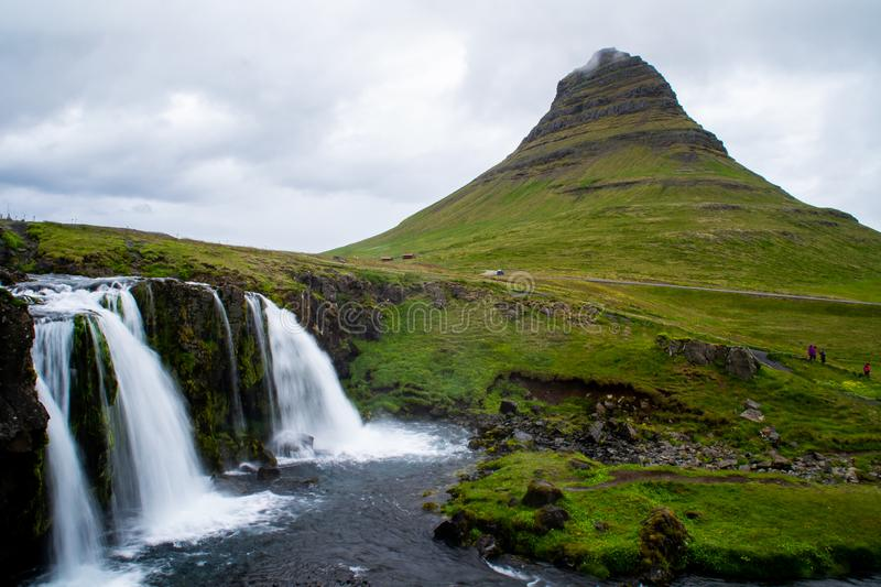 Kirkjufell volcano mountain, long exposure waterfall,  Iceland. Scenic panorama view of long exposure falling water in front of Kirkjufell volcano mountain, the stock image