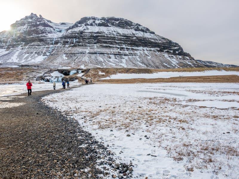 Kirkjufellfoss waterfall in winter, Iceland royalty free stock image