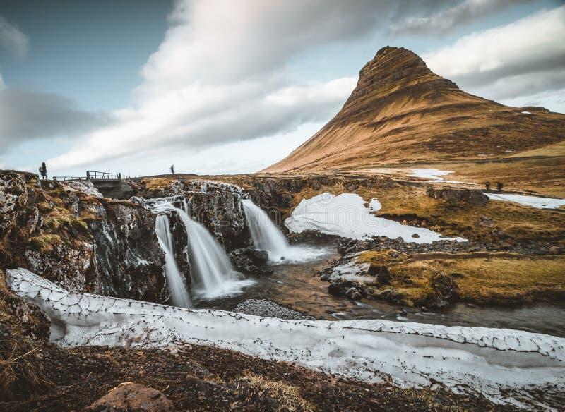 Kirkjufellsfoss and Kirkjufell Icelandic, Church mountain , a 463 m high mountain on the north coast of Iceland`s royalty free stock photos