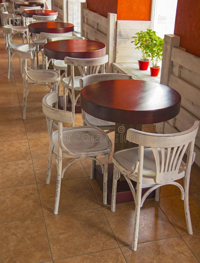 Kirovograd, Ukraine. May 2-2016. View of a Cafe with empty tables and chairs. Interior of summer cafe royalty free stock photos