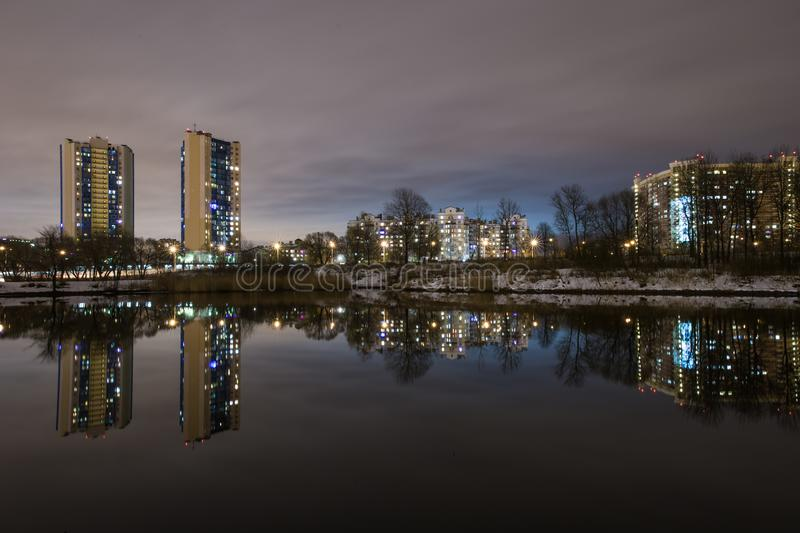 Reflection of high-rise residential buildings in the lake 2. Kirovsky district is an administrative and territorial unit in the south-west of St. Petersburg royalty free stock photos