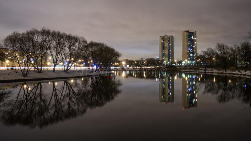 Reflection of high-rise residential buildings in the lake 3. Kirovsky district is an administrative and territorial unit in the south-west of St. Petersburg stock images