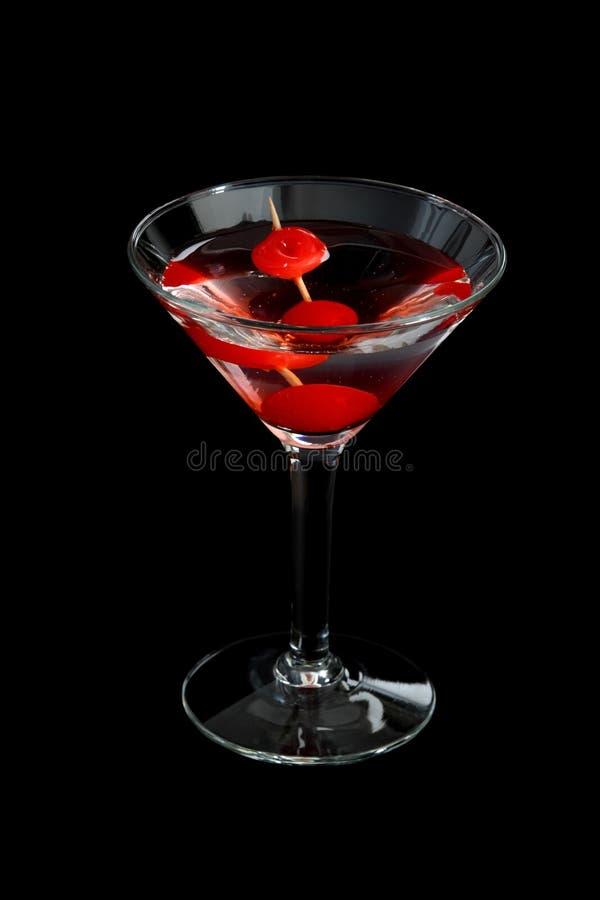Kirsche Martini auf Schwarzem lizenzfreie stockfotografie