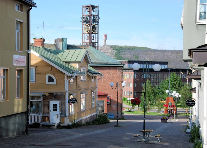 Kiruna Sweden Streetview from center to iron mine,. Kiruna, Sweden, Lapland, View in summer from street in center towards city hall with clock tower and worlds stock photos