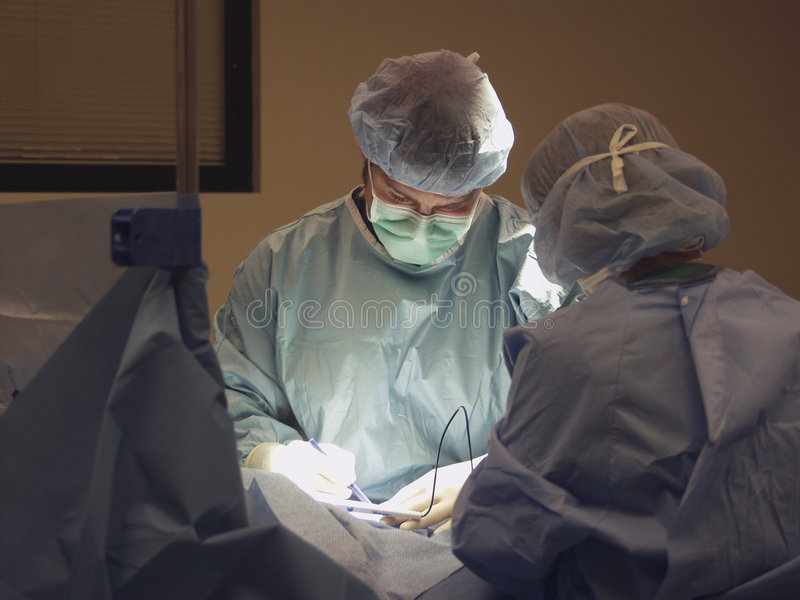 kirurgisk lagworking arkivfoto