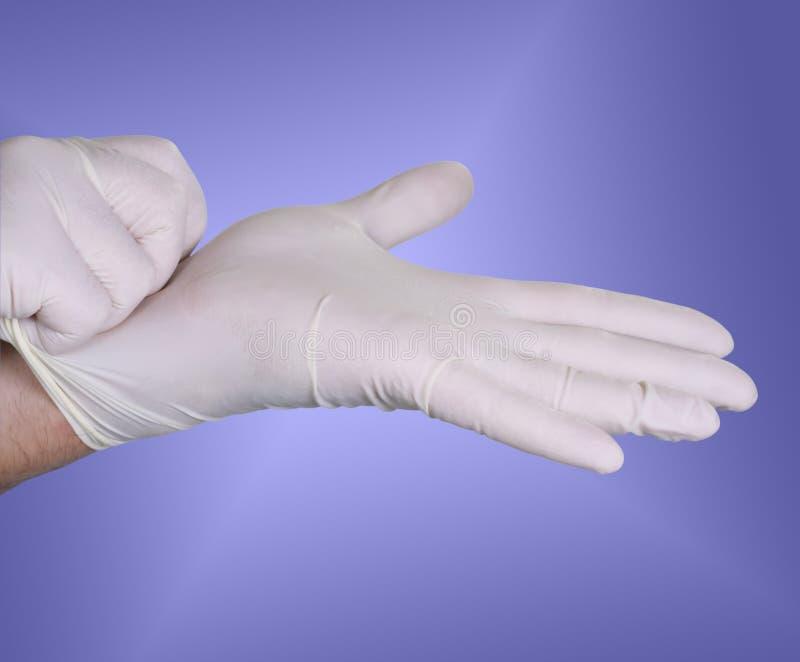 kirurgiska handskar arkivbild