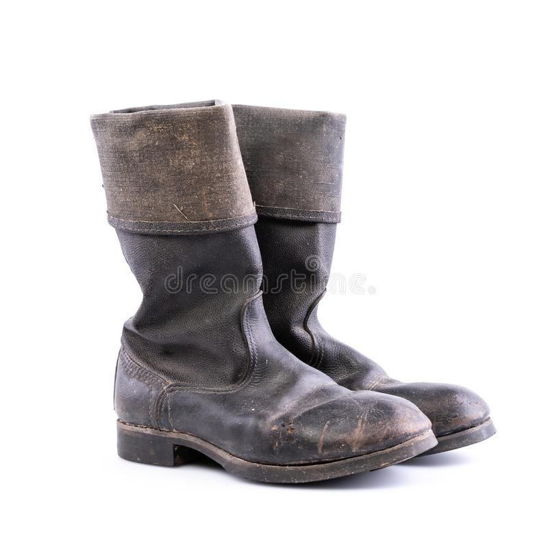 Kirza boots on white background, retro boots, made of artificial leather, used in Soviet Union for soldiers in the army and for. Retro boots - Kirza boots on royalty free stock photos