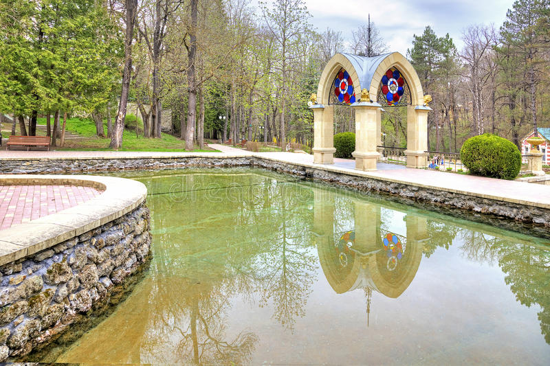 Kislovodsk. Mirror pond and Glass Pavilion stream. Built in 1895. Mirror pond and Pavilion stream. The famous pavilion with an artificial waterfall in the park royalty free stock photography