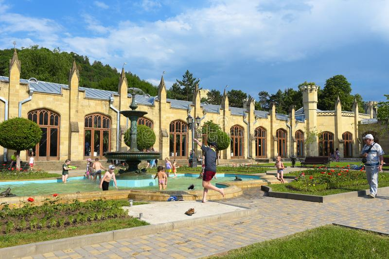 Kislovodsk, Russia - July, 2017: The building of the Narzan gallery. Children playing in fountain.The city centre of Kislovodsk. royalty free stock images