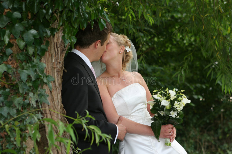 The kiss. The bride and groom kiss after the wedding