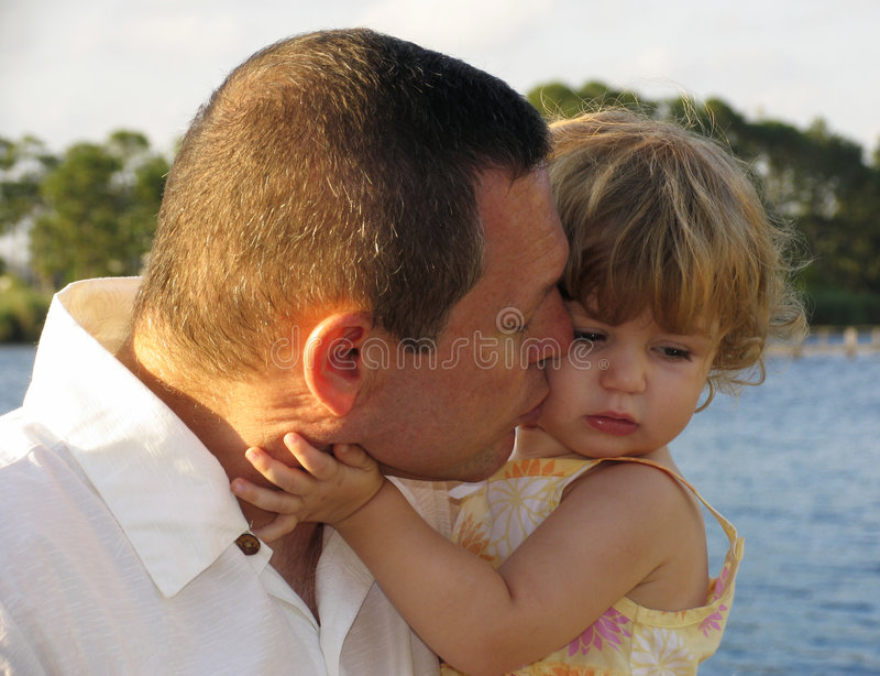 Kiss on the cheek royalty free stock photo