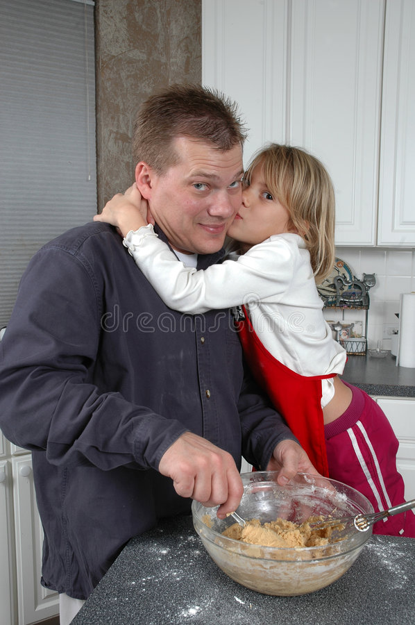 Kiss the cook royalty free stock photos