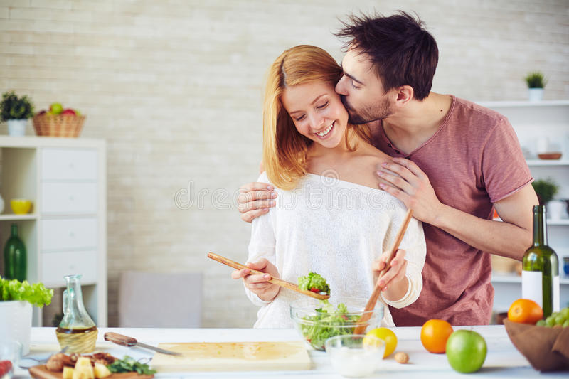Kiss and cook royalty free stock photo