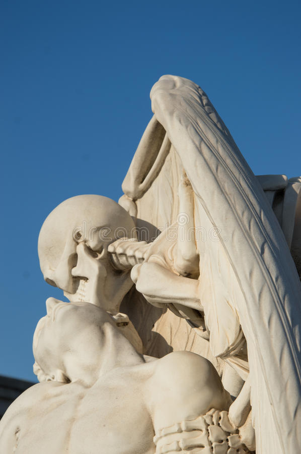 Kiss of death. At poblenou cemetery royalty free stock image