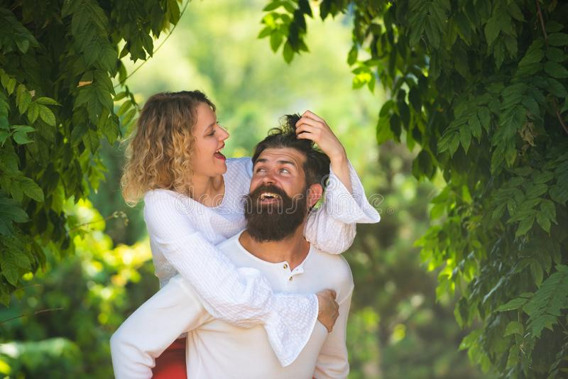 Kiss each other teasing enjoying tenderness and intimacy. Embrace and kiss for couple in love. Intimate relationship and stock photo