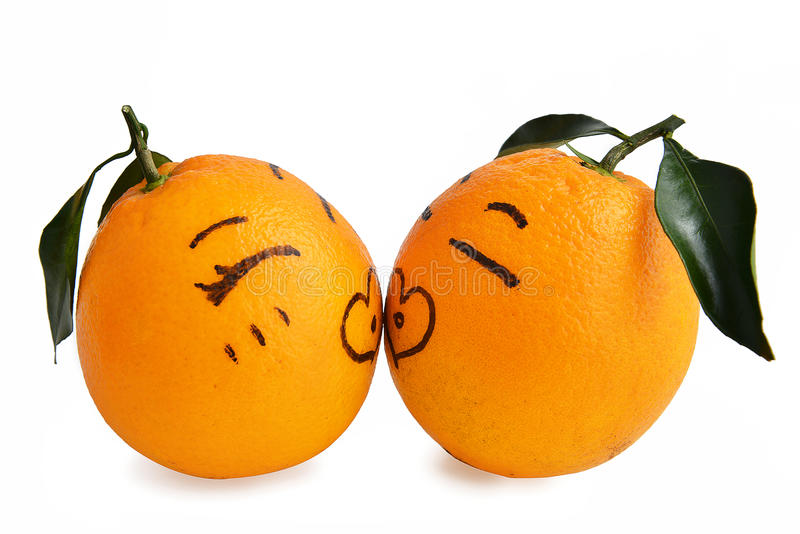 Kiss,Fresh orange Expression of Lovers Cartoon,Creative Poster,Valentine Valentines marriage married marry wedding. Fresh orange of Lovers Cartoon over white royalty free stock photography