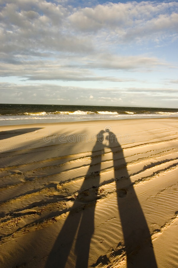 Kiss Kiss.. Shadow of Couple Kissing at the beach stock images