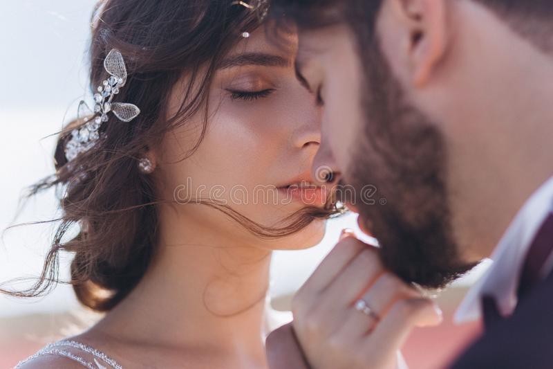 Kiss love bride and groom. stock photos