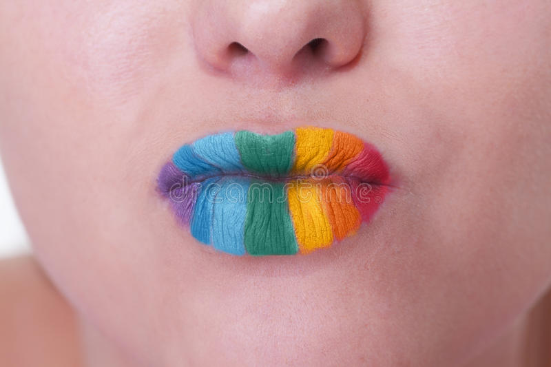 Kiss of the rainbow. Girl with rainbow pattern on lips is ready for kiss stock photography