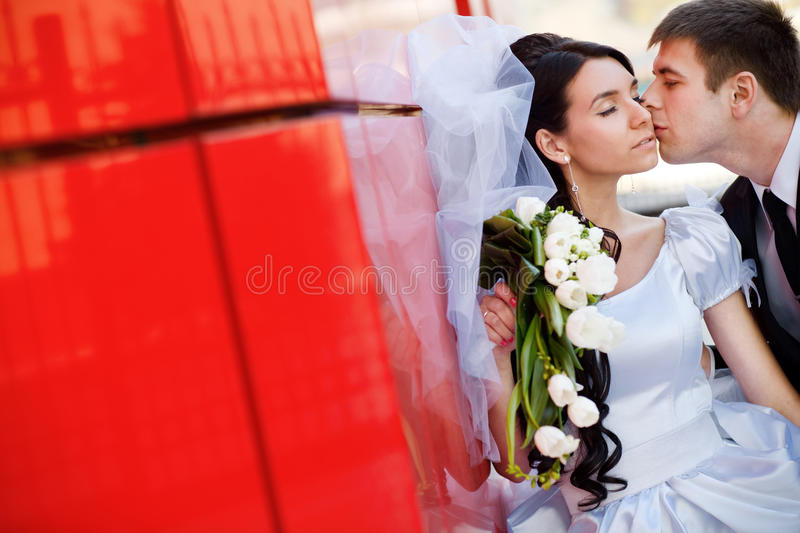 Kiss by the red wall royalty free stock images
