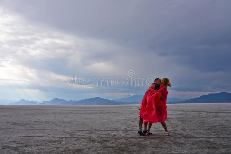 Kiss in a salt flats stock photos