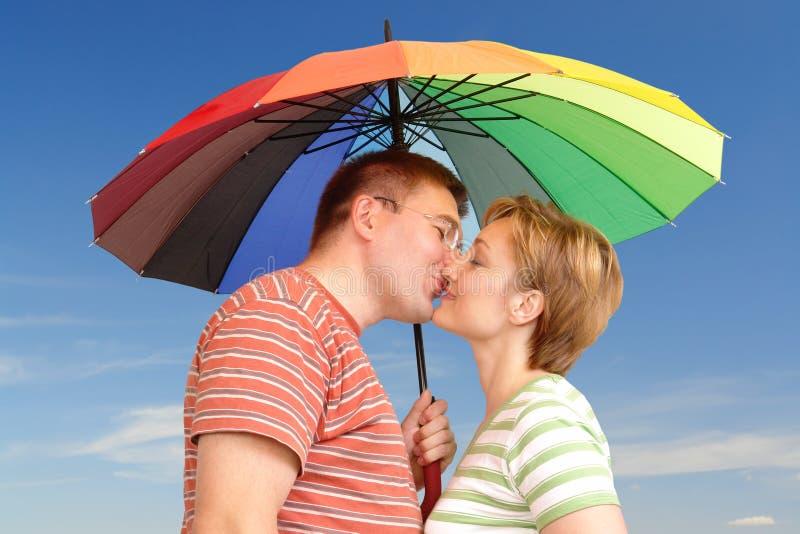 Kiss under umbrella royalty free stock image
