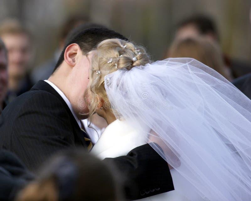 Kiss on wedding stock images
