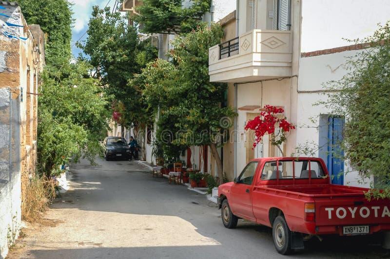 Kissamos in Greece. Kissamos, Greece - May 22, 2007: Street in Kissamos town on the Crete Island stock photos