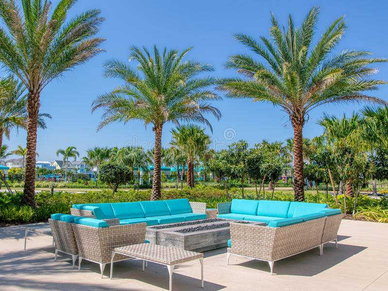 KISSIMMEE, FLORIDA - MAY 29, 2019 - Margaritaville Resort Orlando. Aqua couches under palm trees mark a lounge area for outside. KISSIMMEE, FL. Margaritaville royalty free stock image