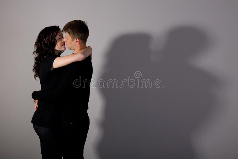Kissing boy and girl stock image