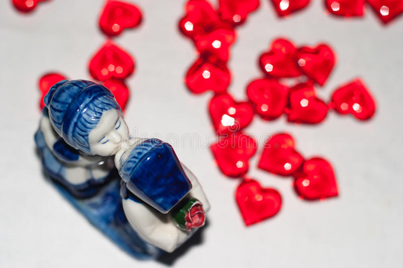 Kissing boy and girl. Statuette. royalty free stock photos