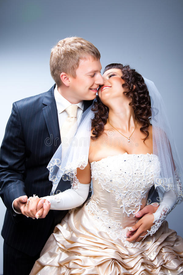 Kissing bride and groom stock photos