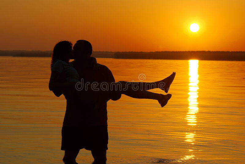 Kissing Couple On The Beach Stock Photography