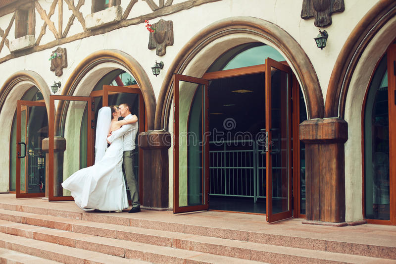 Kissing couple on stairs near building stock images