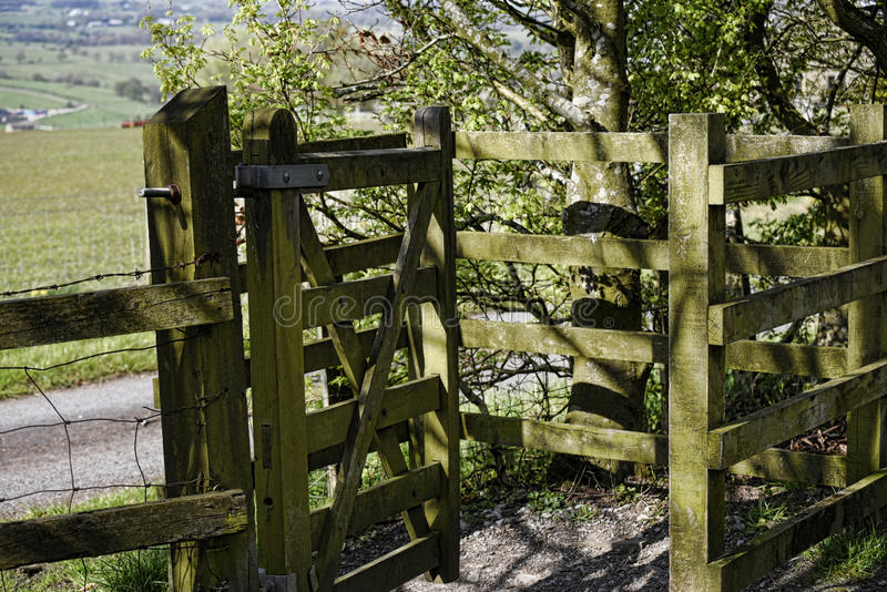 Kissing Gate on the outskirts of Burnley in a shadow of Pendle Hill in Lancashire. Although an industrial town, Burnley is surrounded by famrs and countryside royalty free stock photography