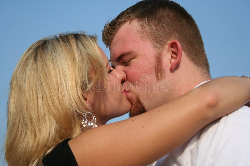 Kissing lovers stock photo