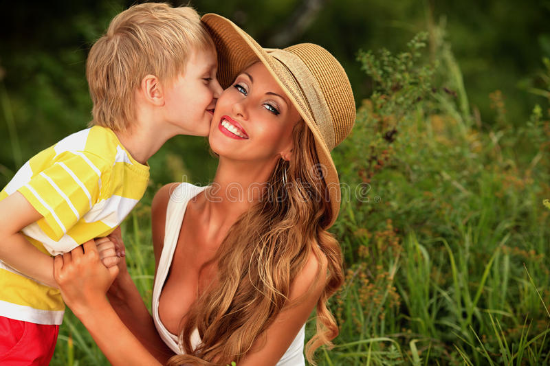 Download Kissing mom stock image. Image of casual, love, child - 35369179