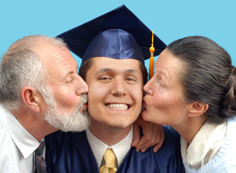 Kissing the new graduate royalty free stock photo