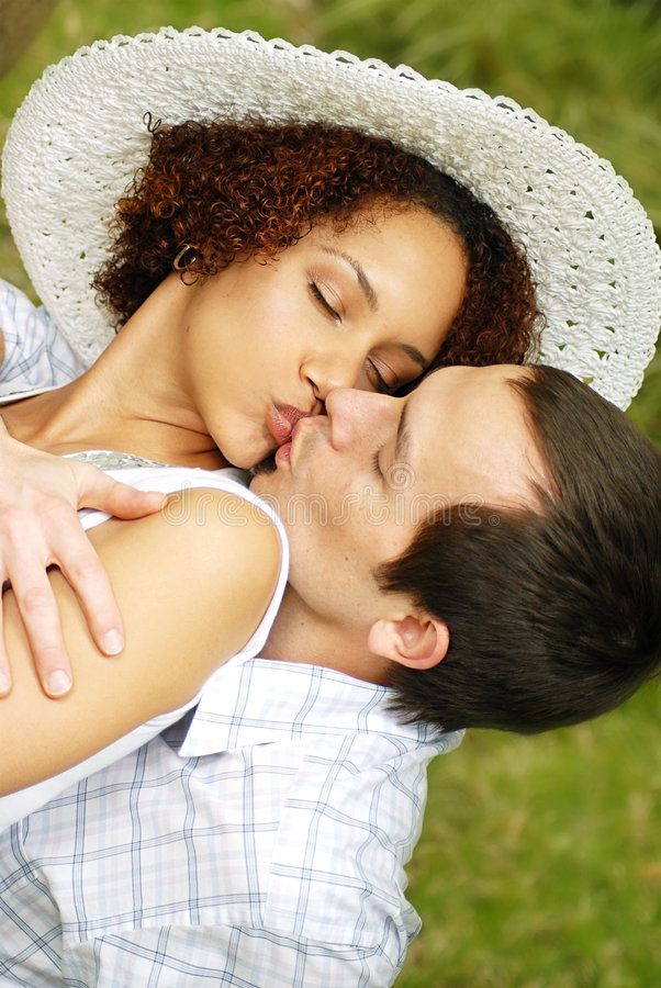 Kissing in the park royalty free stock images
