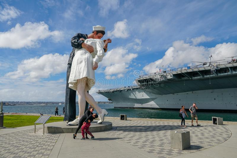 Kissing sailor statue, Port of San Diego. Also known as Unconditional Surrender. Recreates famous embrace between a sailor and a nurse celebrating the end of stock photo