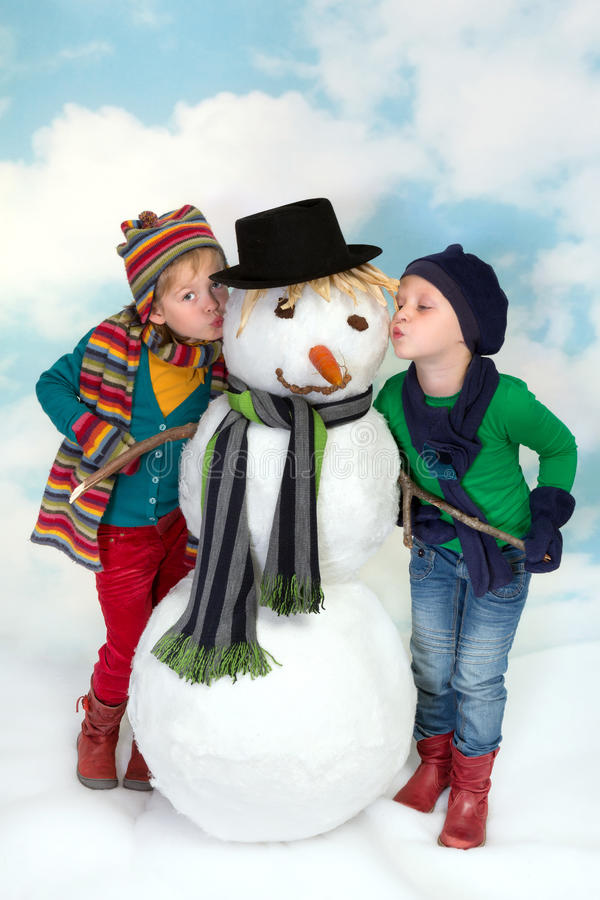 Download Kissing a snowman stock photo. Image of junior, making - 27687298