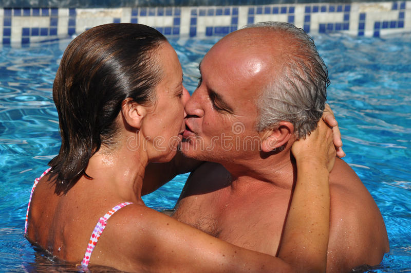 Kissing In A Swimming Pool Royalty Free Stock Photo
