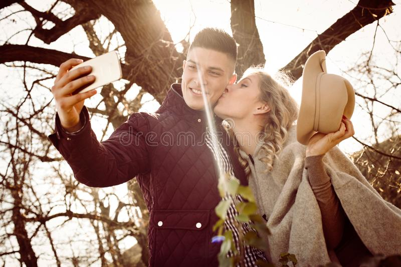 Kissing and taking self picture. royalty free stock photos