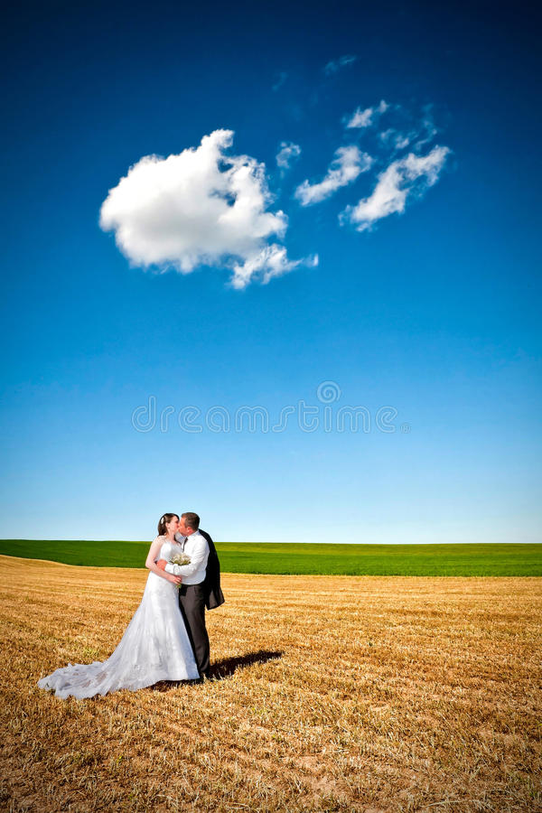 Kissing under the clouds stock image