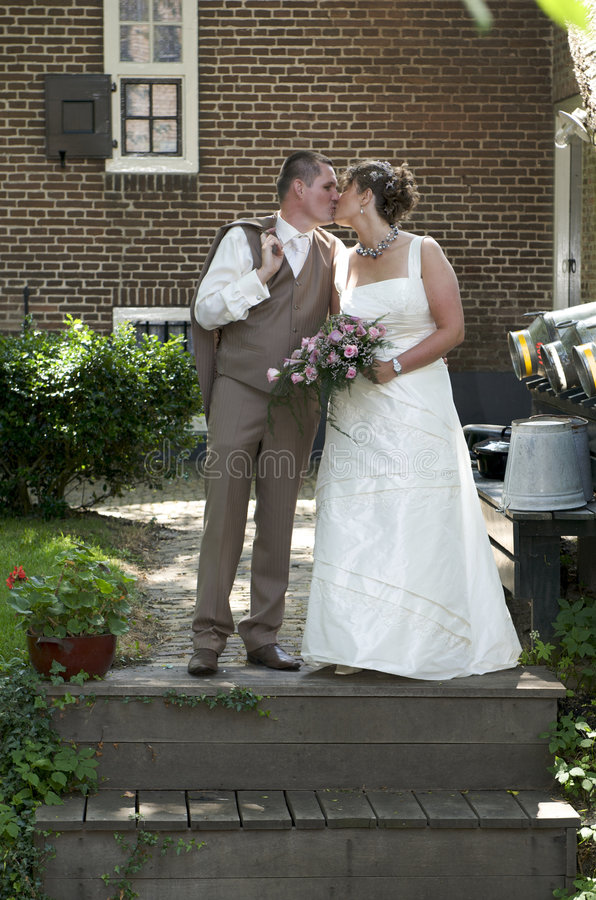 Download Kissing wedding couple stock photo. Image of farm, countryside - 7133946