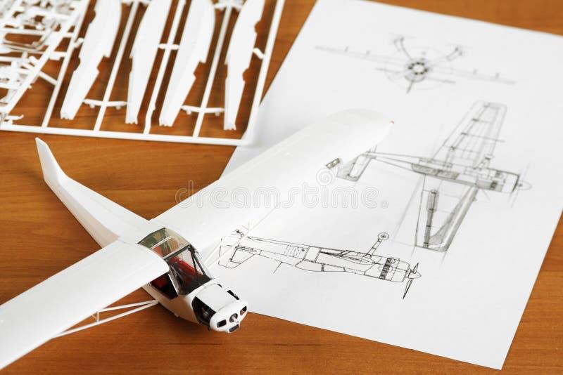 Kit for assembling plastic airplane model. Kit for assembling white plastic airplane model with scheme stock photography