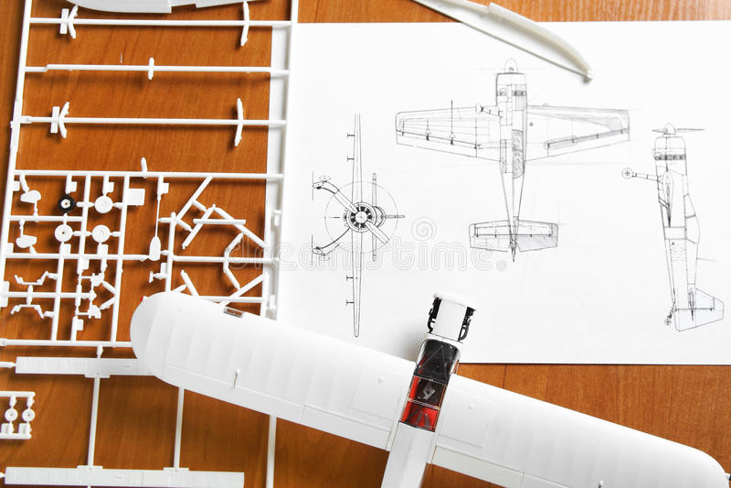 Kit for assembling plastic airplane model. Kit for assembling white plastic airplane model with scheme royalty free stock image