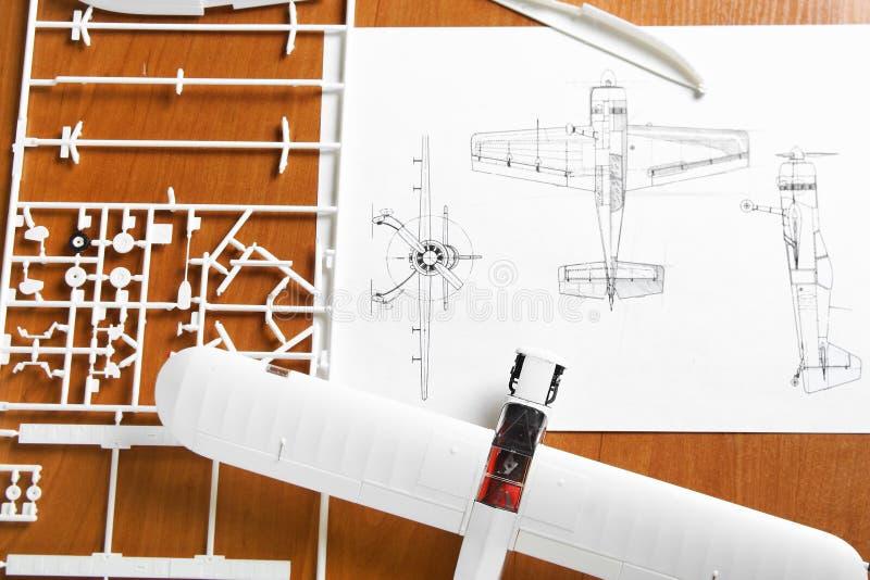 Kit for assembling plastic airplane model royalty free stock image