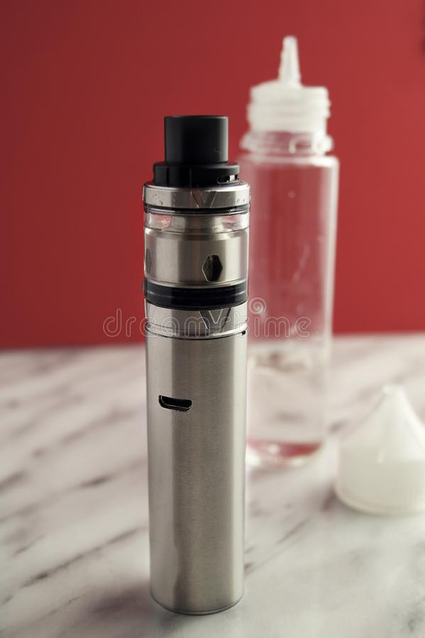 Kit for healthy smoking on table. E-cigarette stock photo